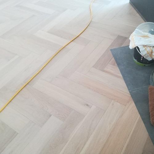 Visgraat vloer Amstelveen